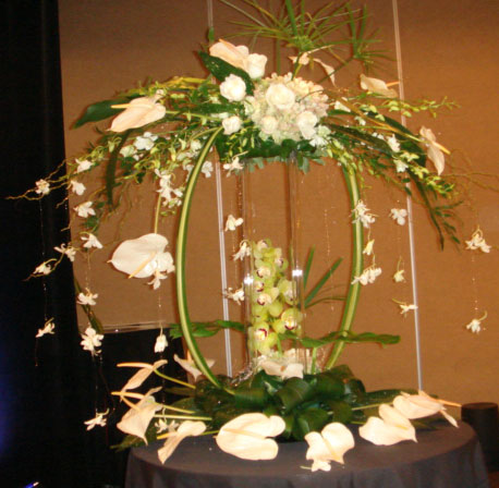 White Anthuriums and Orchids demonstration arrangement by Phil Rulloda