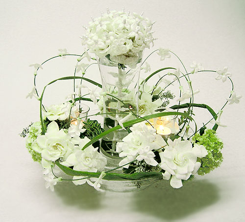 Stephanotis and Gardenia centerpiece with central cluster bouquet